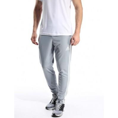 pantaloni adidas grigi e bianchi